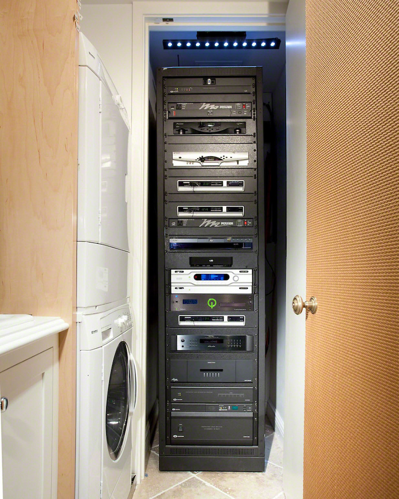 the hidden home theater hiding surround sound in an older home av rack closet