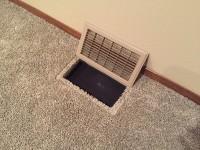 in-floor subwoofer vent open