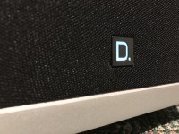 Definitive technology glowing D on each speaker